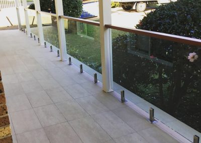 ST Ives Frameless Glass Balustrade with Timber Toprail